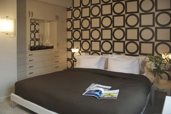 art collector new york bedroom with geometric design on wall