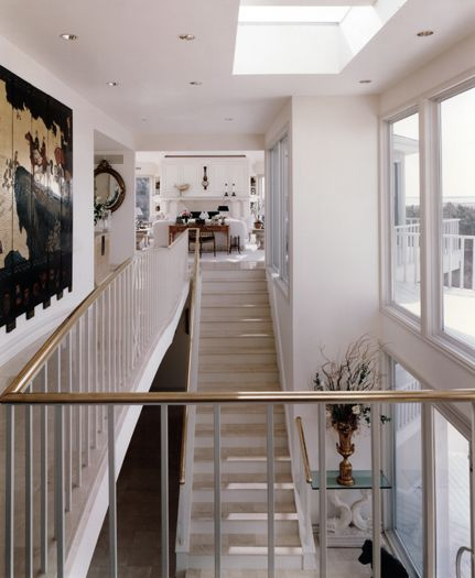 white furnishings ocean view interior with staircase