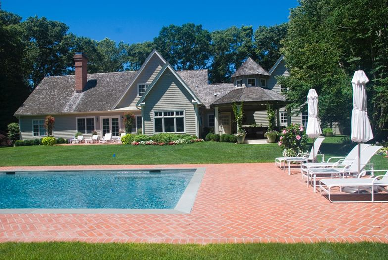 Pool and exterior of East Hampton home