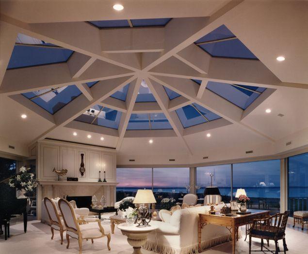 dramatic skylight white livingroom interior design ocean view